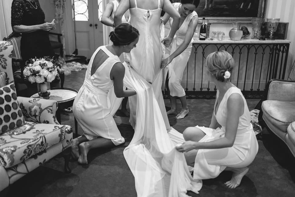 bride and bridesmaids getting ready for wedding at bendooley estate homestead in bowral southern highlands