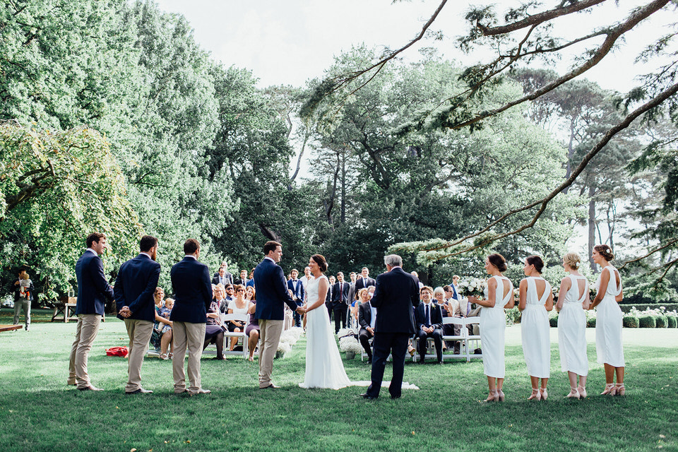 relaxed outdoor modern white flower bouquets held by bridesmaids at wedding ceremony at bendooley estate in bowral southern highlands