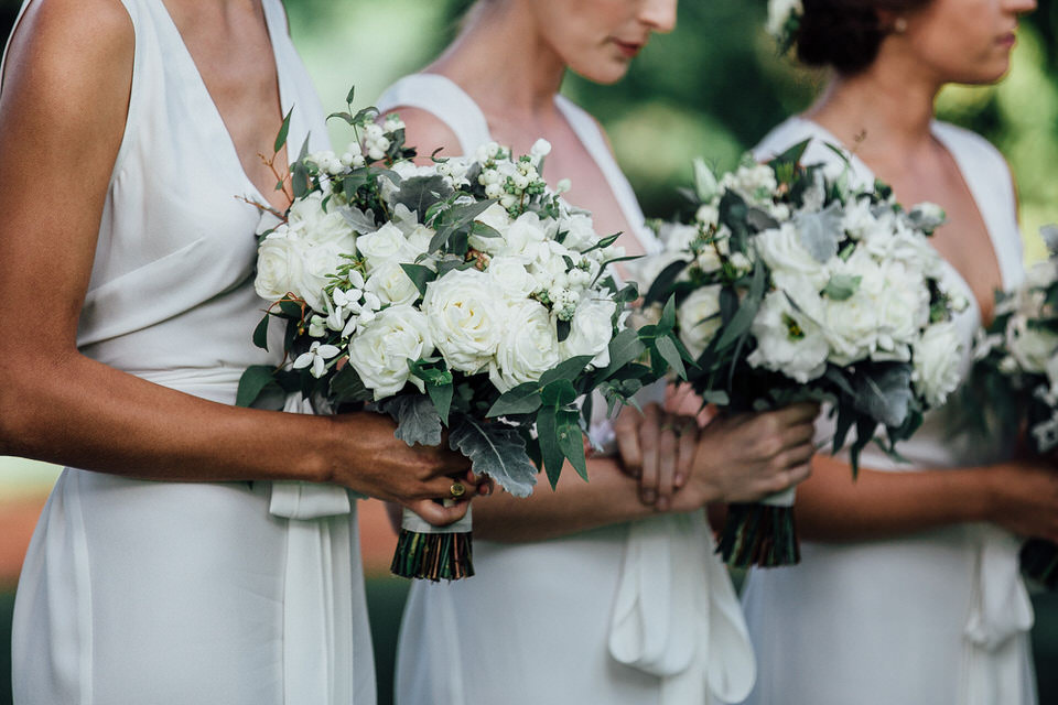 modern white flower bouquets held by bridesmaids at wedding ceremony at bendooley estate in bowral southern highlands