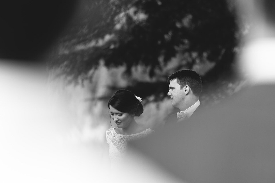 candid photo of bride and groom during wedding ceremony at bendooley estate in bowral southern highlands