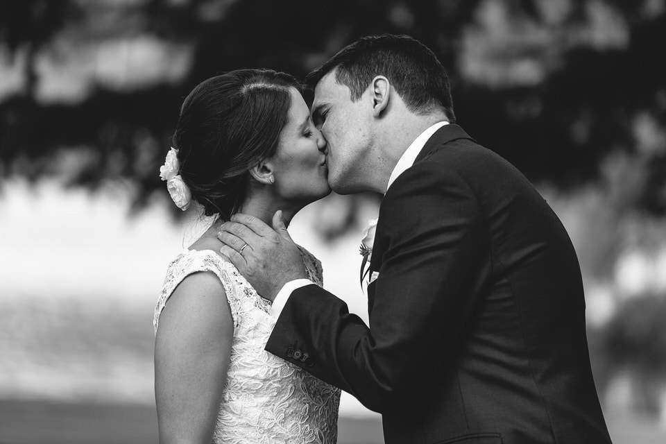bride and groom first kiss at ceremony at bendooley estate in bowral southern highlands