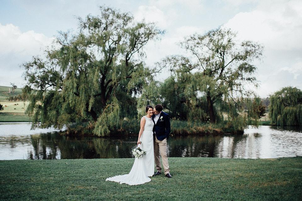 bride and groom at bendooley estate lake in bowral southern highlands