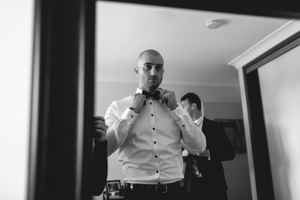 Groom getting ready at home in Sydney before wedding ceremony