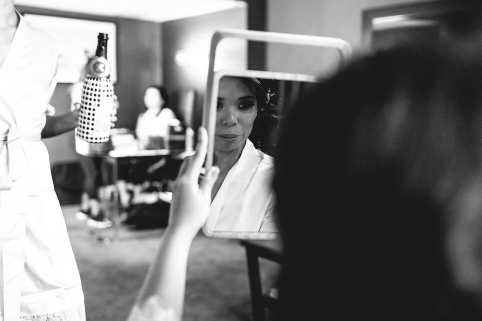 Bride looking in mirror at Sydney Intercontinental Hotel