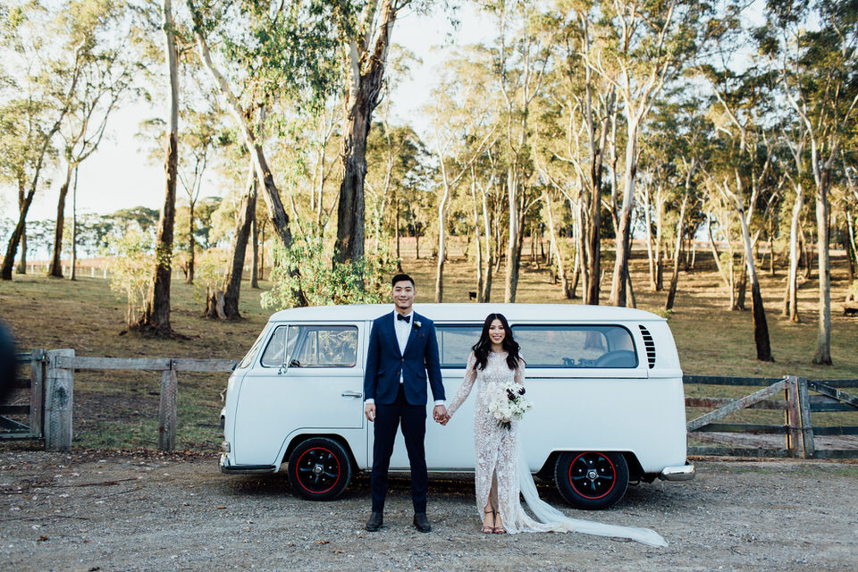 Bride and groom in front of vintage VW kombi at Centennial Vineyards