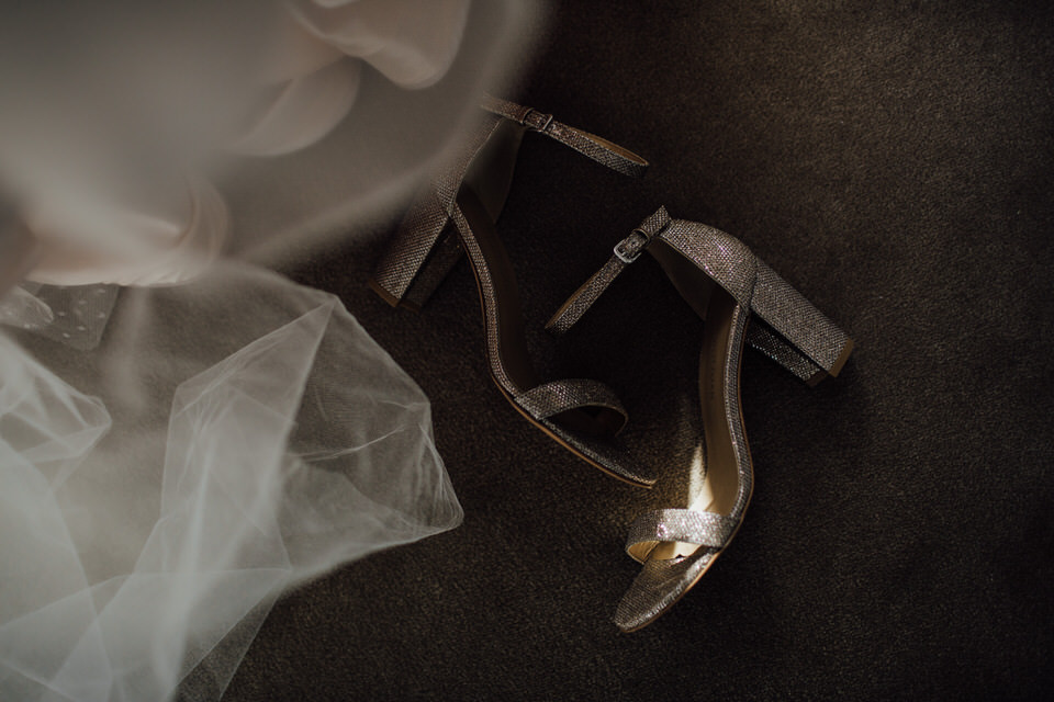 Brides dress and shoes in shadows