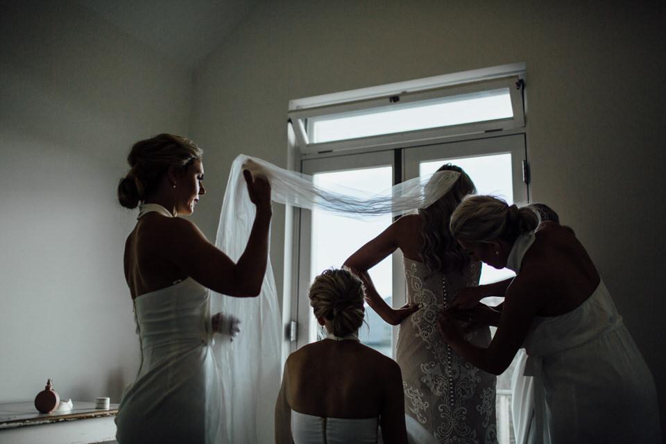 Bridesmaids helping bride get ready in Vaucluse Sydney