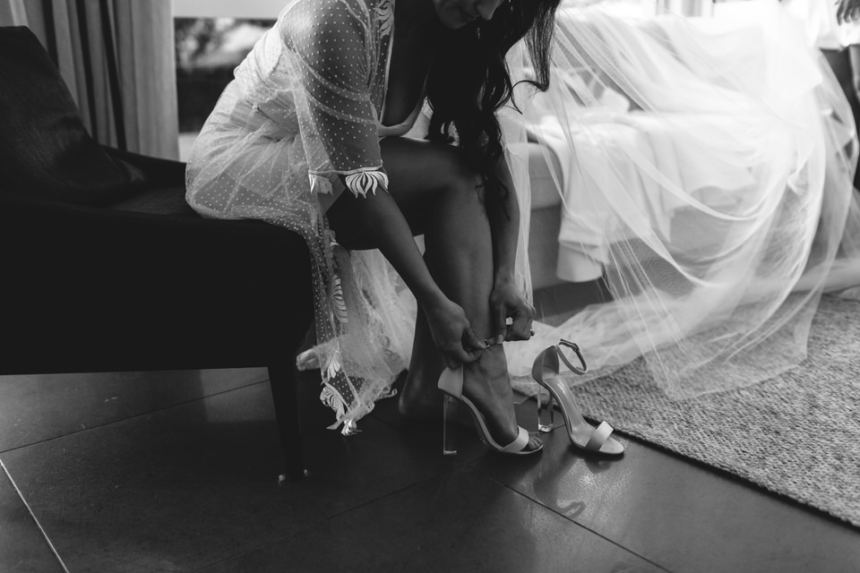 Bride putting on shoes in Austinmer South Coast