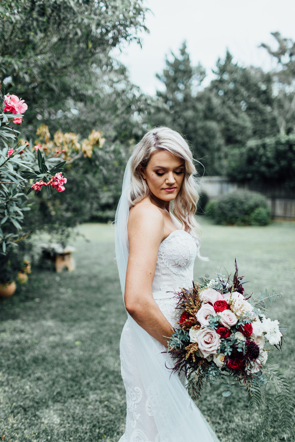 Bride wearing dress by Malachi Empire and holding Verda Flore bouquet in Vaucluse Sydney