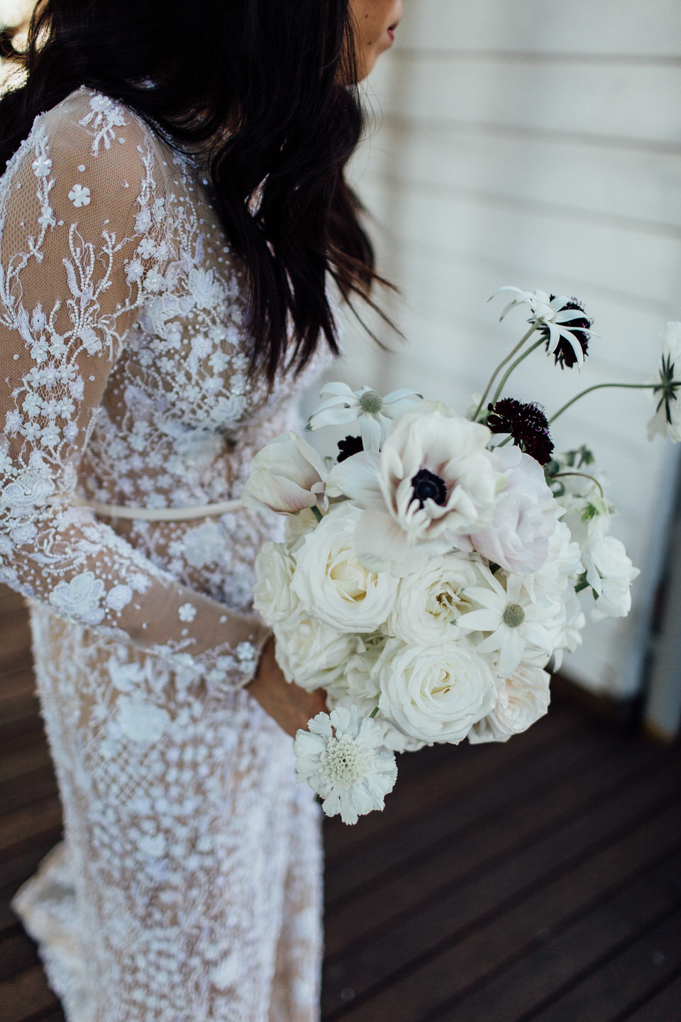 Bride wearing Jane Hill Bridal dress and holding white flowers by Sophie Rothwell florist