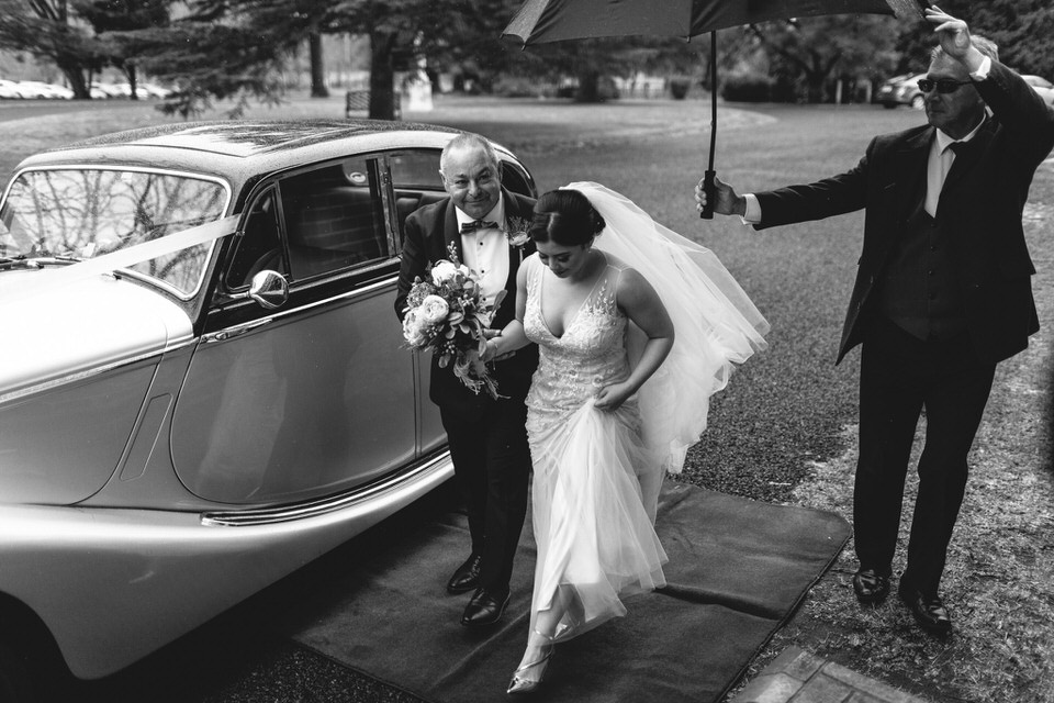 Bride arriving to church with father