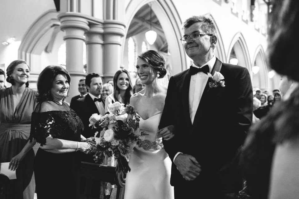Bride and father walking down aisle at Our Lady of the Sacred Heart Church in Randwick