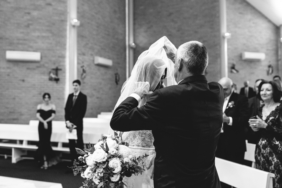 Bride and father at church ceremony