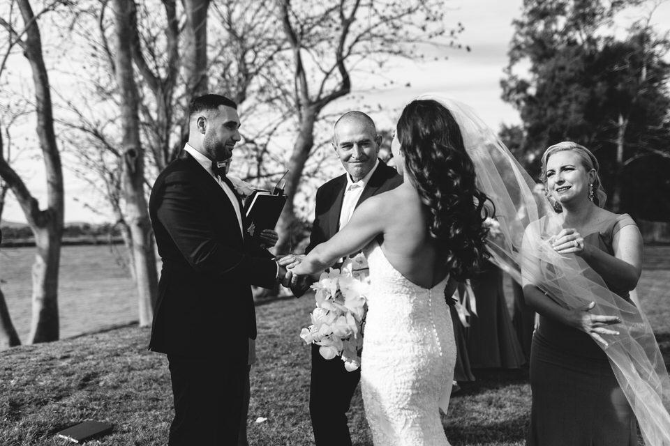 Father giving bride away at Terara Riverside Retreat wedding ceremony