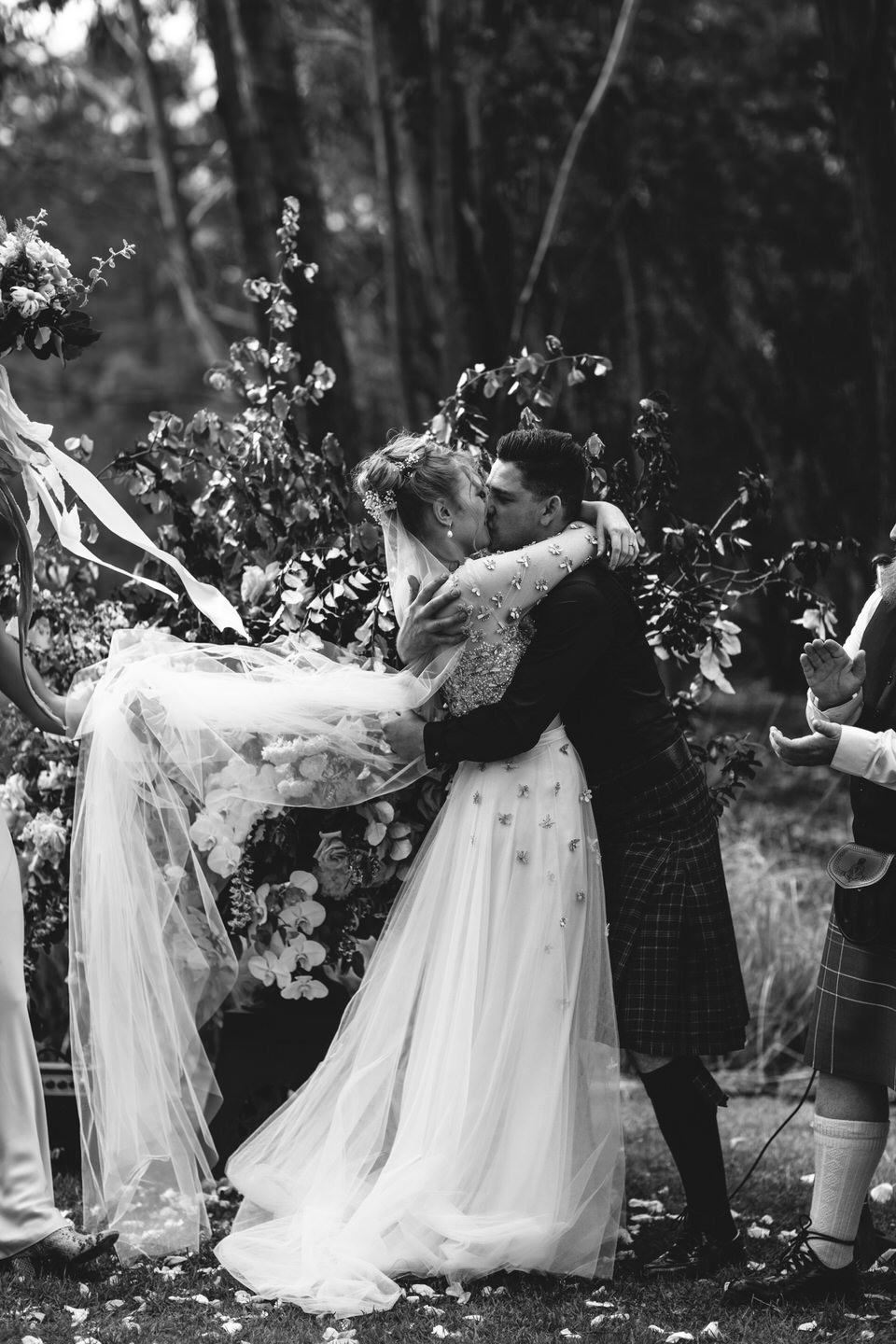 Bride and groom kiss at Wombat Hollow wedding ceremony in Southern Highlands