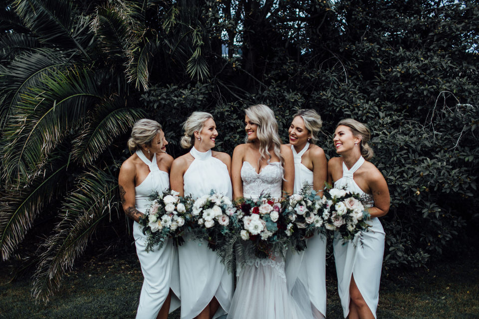 Bride and bridesmaids in front of greenery at Vaucluse