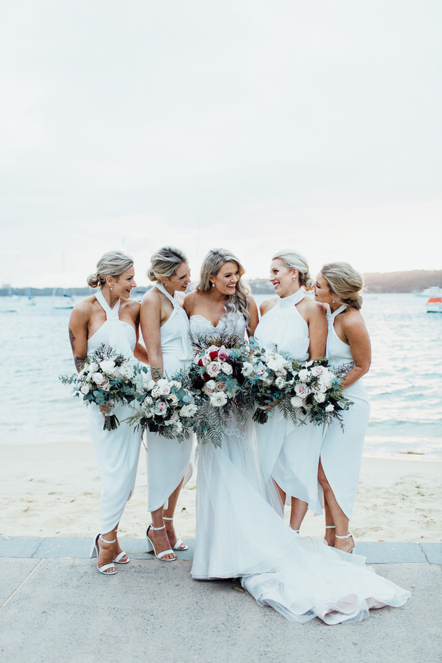 Bride and bridesmaids at Watsons Bay in front of water