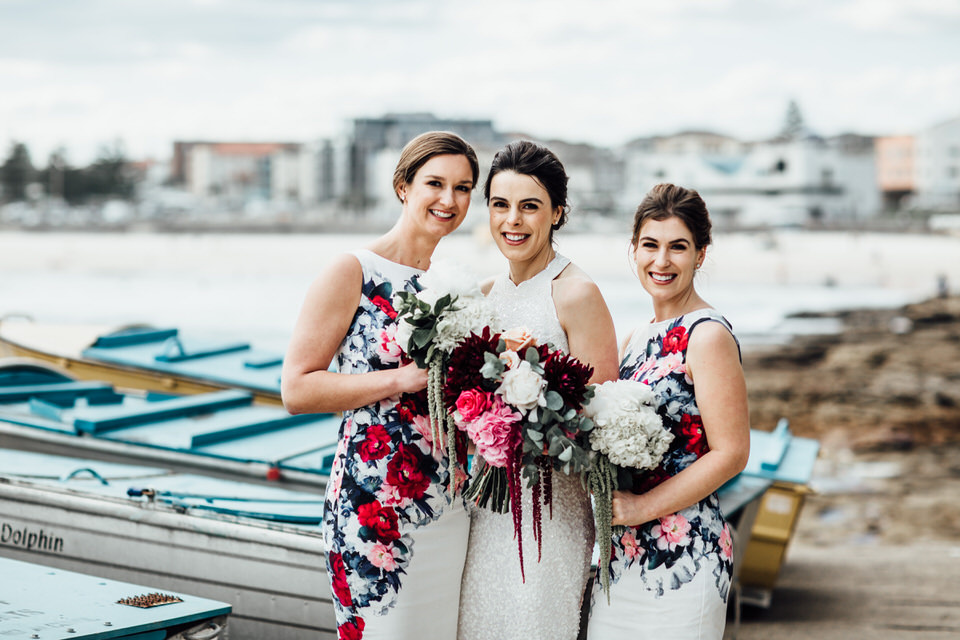 Bride and bridesmaids at Bondi Beach wedding