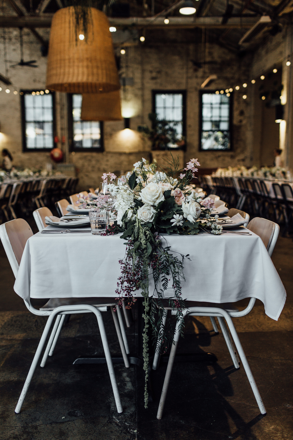 Three Blue Ducks Rosebery wedding reception styling with flowers