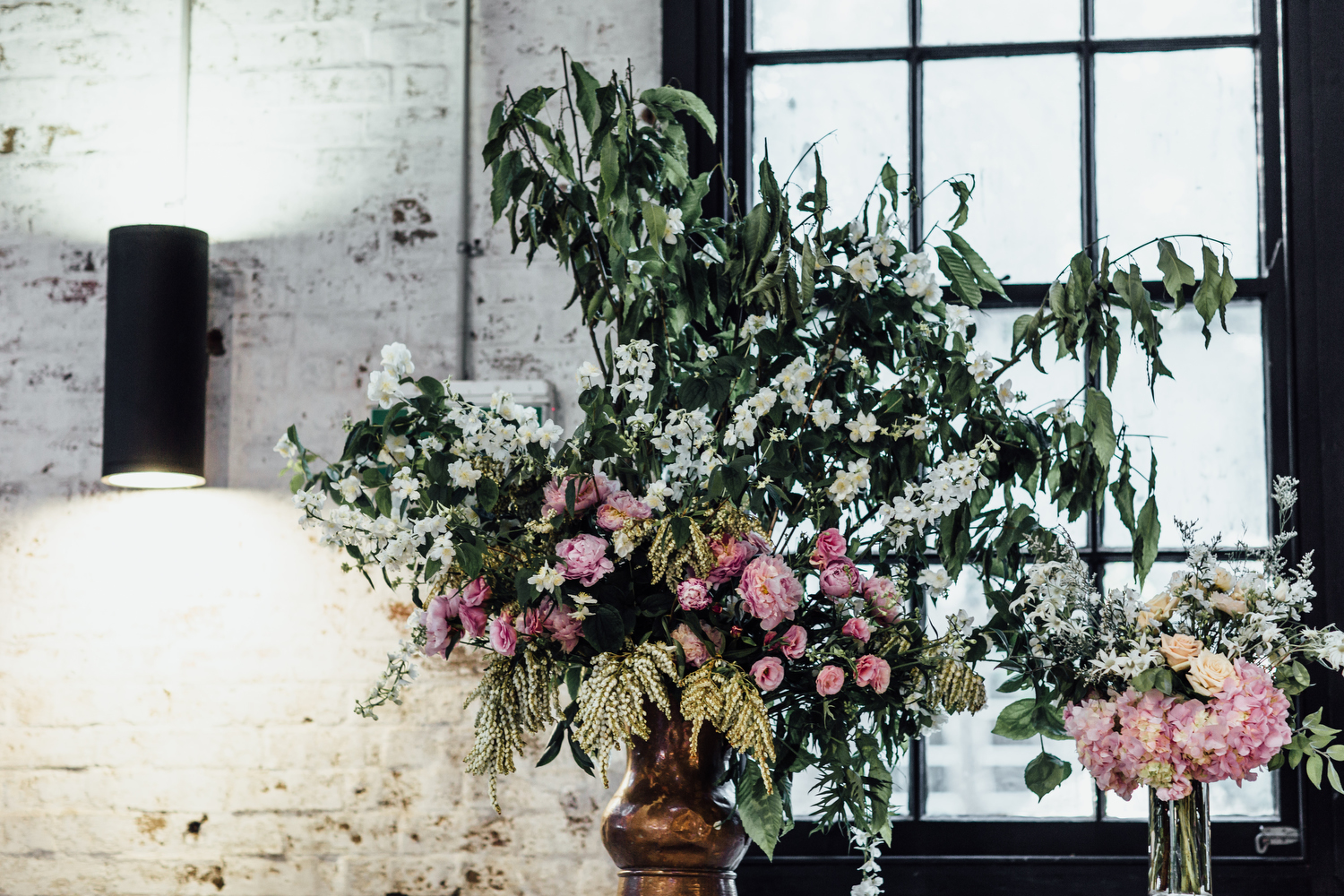 Three Blue Ducks Rosebery wedding reception styling with large flower urn