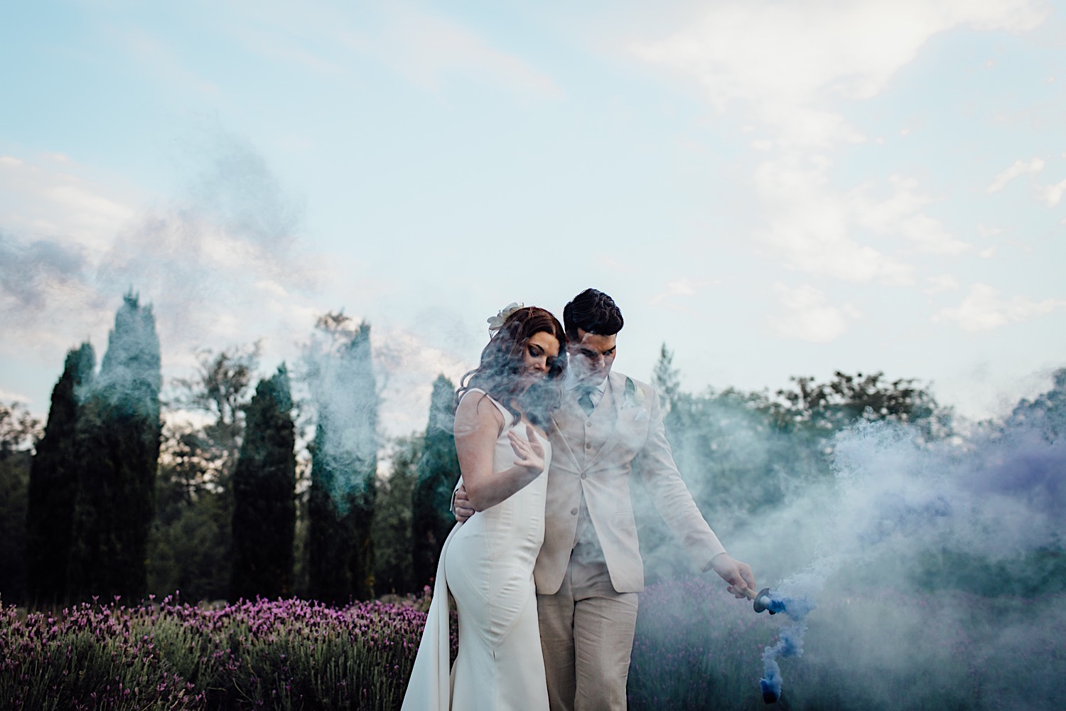 Bride and groom with coloured smoke bombs at Redleaf wedding in Hunter Valley