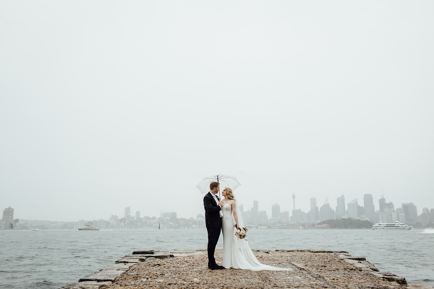 bride and groom at Bradleys head on a rainy day